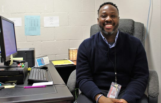 Thurmond Mettles in his small office in the eighth-grade wing at Madison Middle School, where he has served as a campus coach for 13 years.