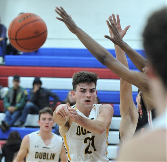 Dublin's Jacob Stanley (21) passes the ball to a teammate during the Lions' game against Colorado City. The Wolves beat Dublin 74-59 in the Region I-3A bi-district playoff game Tuesday, Feb. 19, 2019, at Abilene Cooper's Cougar Gym.