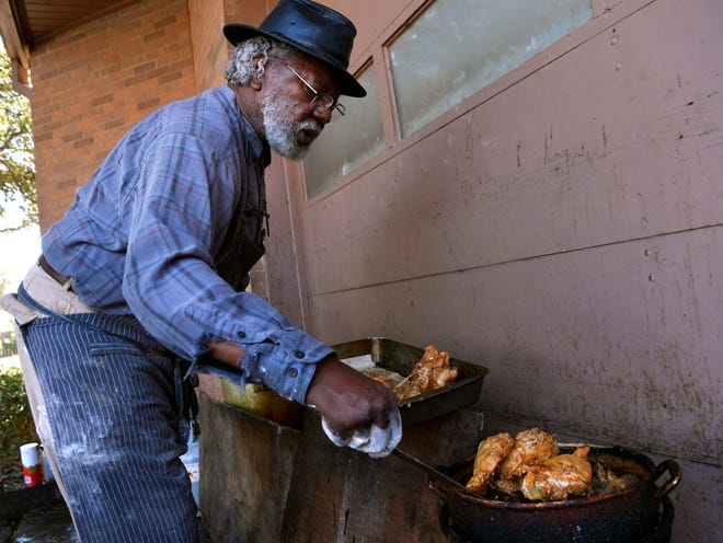 Fishing chicken out of a fryer, Rev. Iziar Lankford cooks lunch Feb. 12 for his noon soup kitchen at Southwest Drive Community United Methodist Church in Abilene.