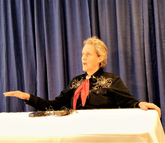Temple Grandin speaks to reporters at the Taylor County Expo Center Wednesday.