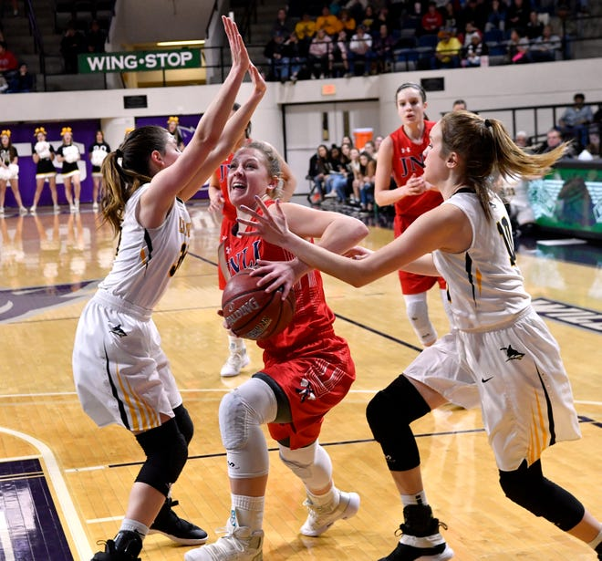 Jim Ned's Claire Graham pushes through the Cisco defense as she goes up for a basket during Tuesday's Region I-3A basketball quarterfinal at Abilene Christian University Feb. 19, 2019. Final score was 46-31, Jim Ned.
