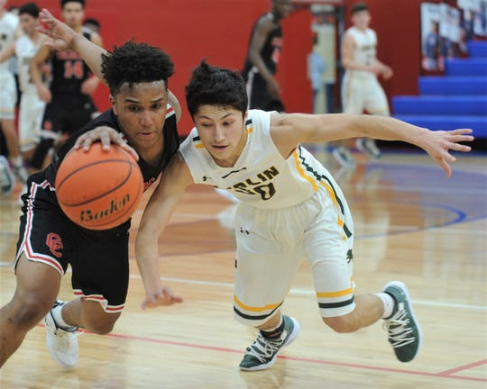 Colorado City's Markis Monroe, left, steals the ball away from Dublin's Angel Ramirez in the second half. The Wolves beat Dublin 74-59 in the Region I-3A bi-district playoff game Tuesday, Feb. 19, 2019, at Abilene Cooper's Cougar Gym.