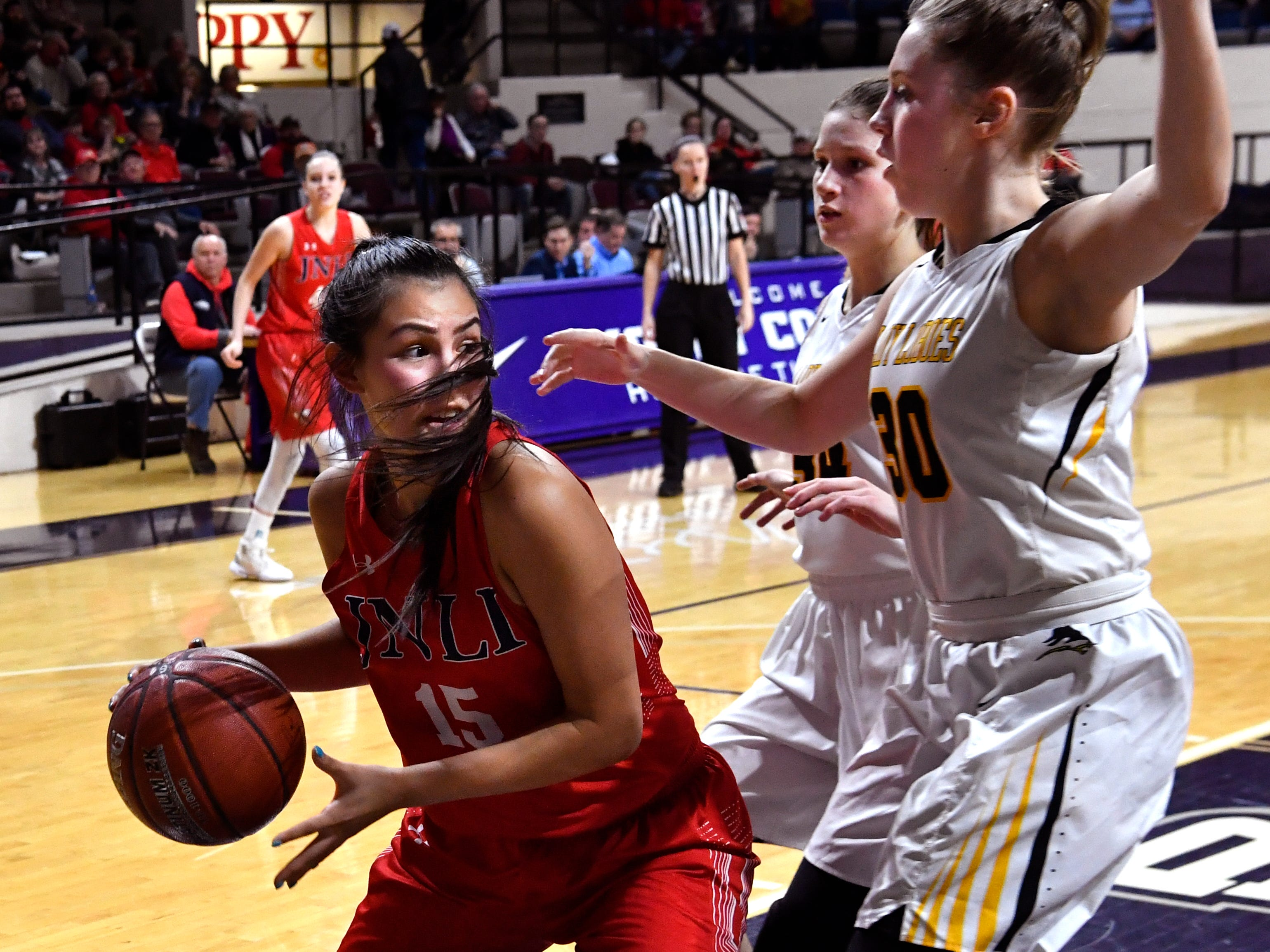 Jim Ned's Alexis Espinosa closes on the basket during Tuesday's Region 1 3A basketball all quarter-finals at Abilene Christian University Feb. 19, 2019. Final score was 46-31, Jim Ned.