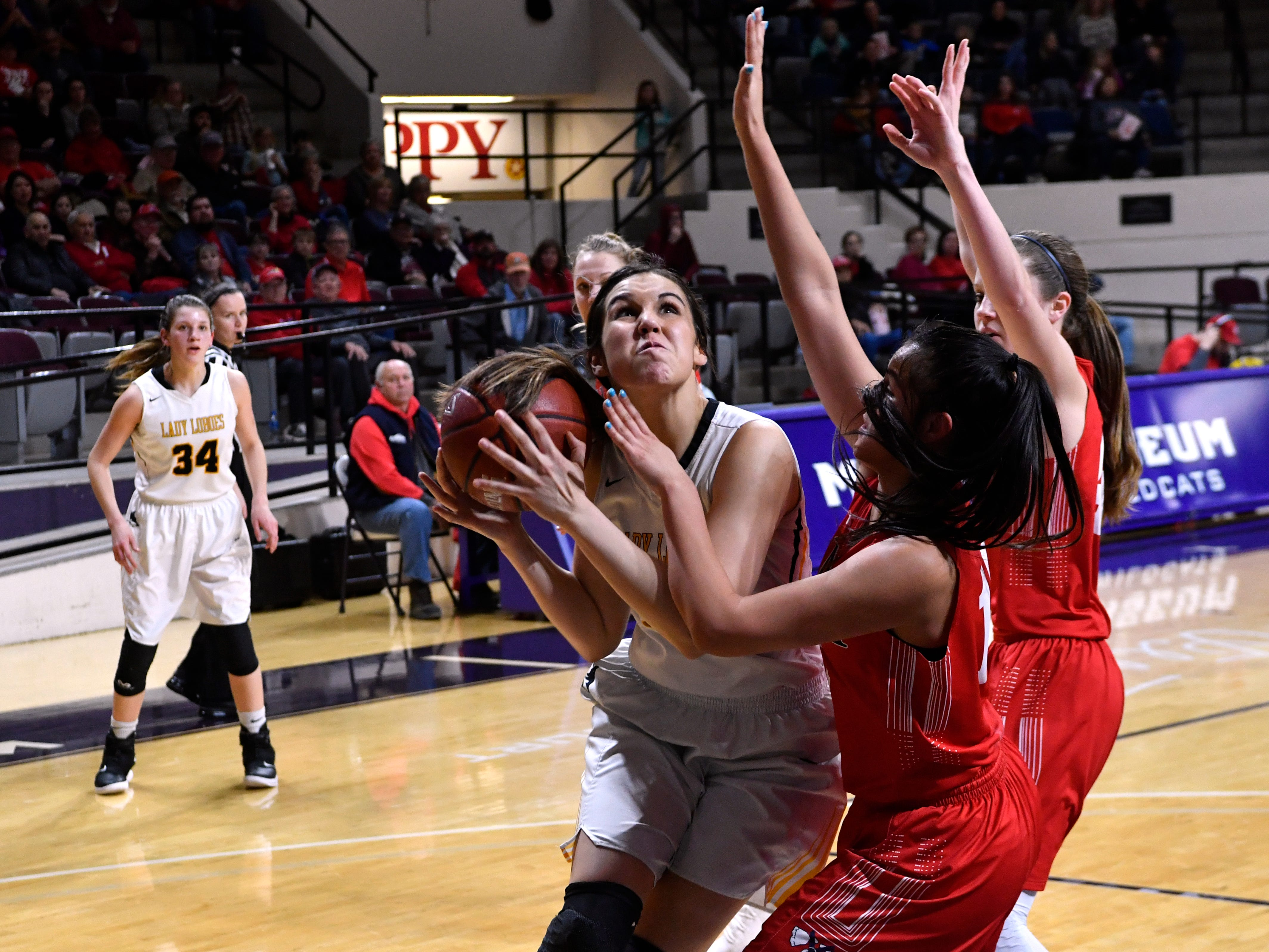Cisco's Sophie Hurtado shoulders the Jim Ned defense as she goes up for a basket during Tuesday's Region 1 3A basketball all quarter-finals at Abilene Christian University Feb. 19, 2019. Final score was 46-31, Jim Ned.