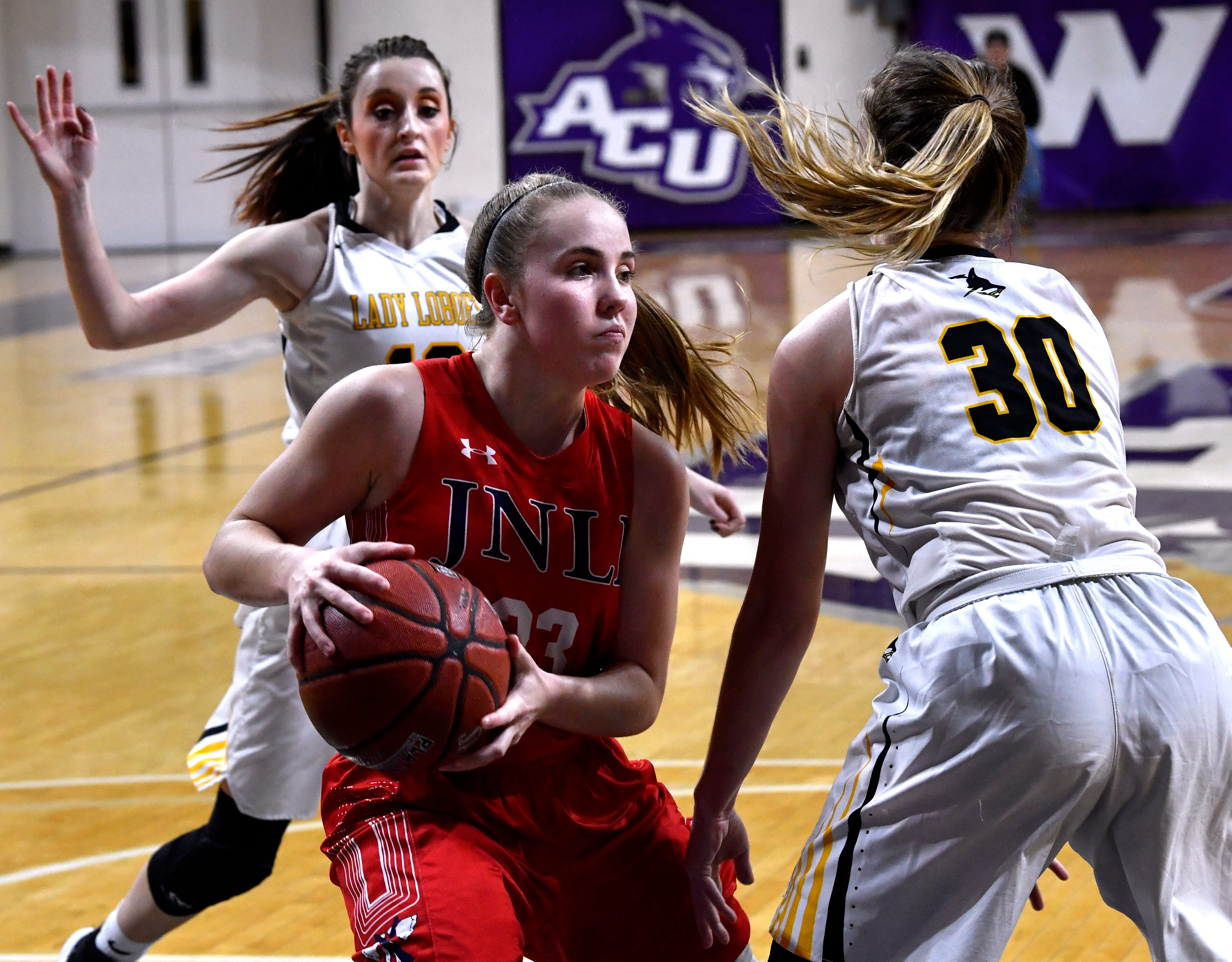 Jim Ned's Brooke Galvin steps around Cisco's Savannah Dycus during Tuesday's Region 1 3A basketball all quarter-finals at Abilene Christian University Feb. 19, 2019. Final score was 46-31, Jim Ned.