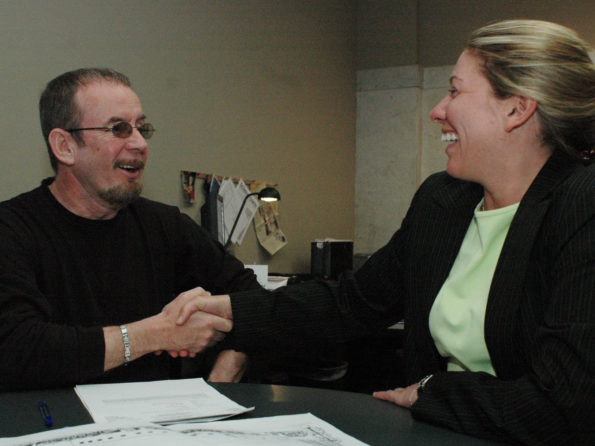 -  In this 2015 photo, Gary Fields shakes hands with Kathleen Erickson, downtown development director for Battle Creek Unlimited, Tafter he signed a sales agreement to purchase the United Art's Council's Discovery Theatre on West Michigan Ave.