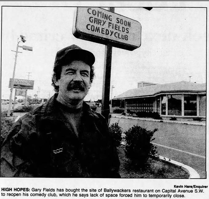 In this 1994 photo, Gary Fields stands in front of his comedy club on Capital Ave. S.W.