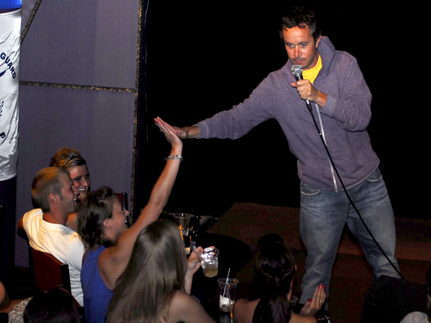 Comedian and actor Pauly Shore high fives a member of the audience during his 2008 performance at Gary Fields Comedy Club Theatre.