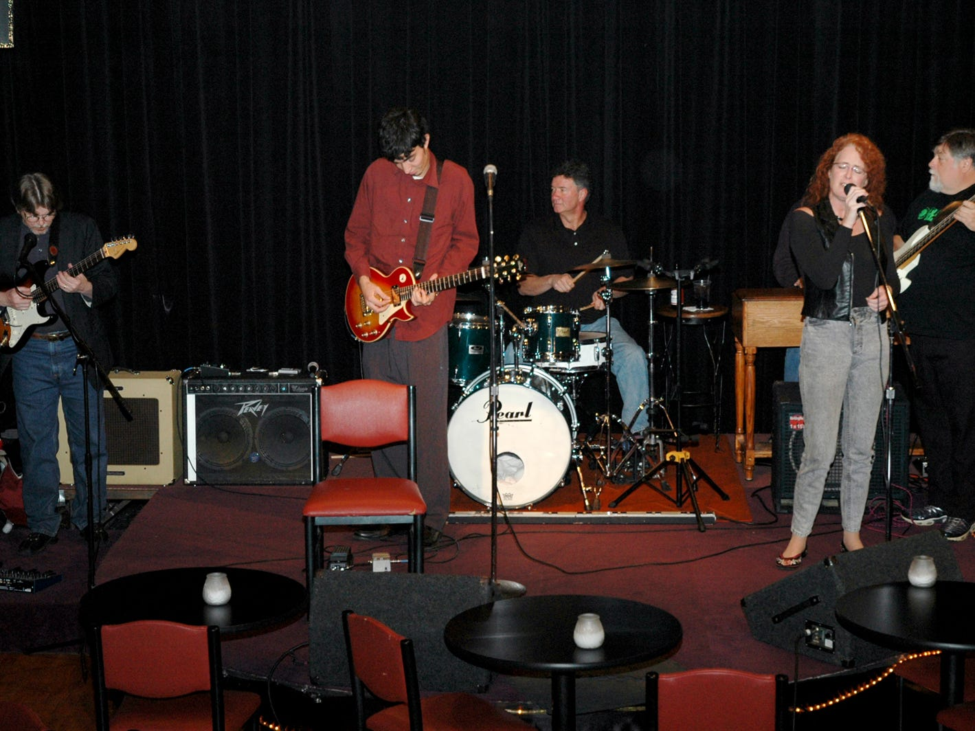 Gary Fields Rock Band members guitarists Jim Klein and Eddie Robinson, drummer Bryon Taber, singer Debbie Ploehn, bass player Tom Sharp, and organist Harry Robinson play their show at Gary Fields Comedy Club in 2007.