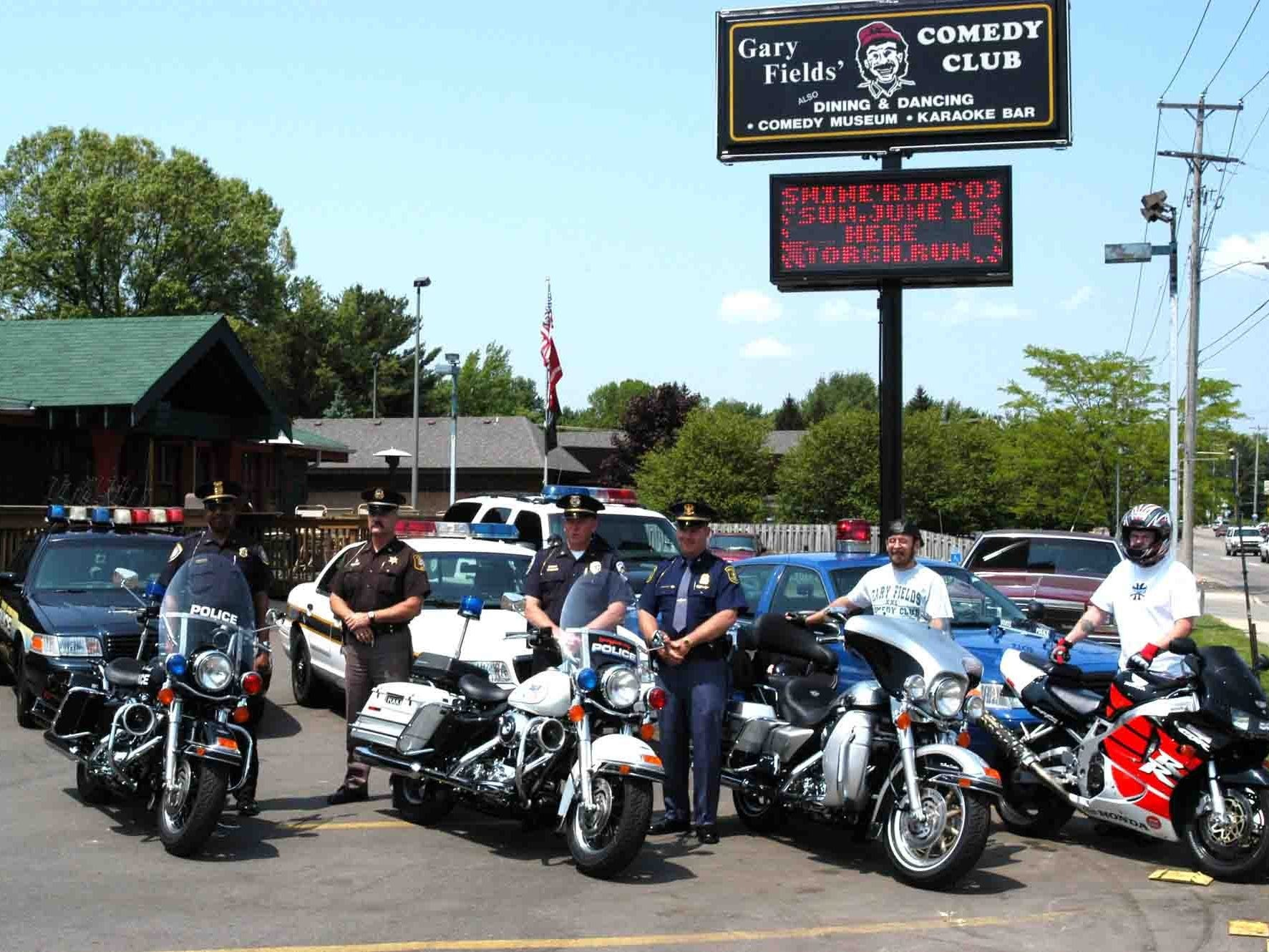 In this 2003 photo, members of the Battle Creek Police, Calhoun County Sherriff Department, Springfield Department of Public Safety and the Michigan State Police pose in the parking lot of Gary Fields' Comedy Club on Capital Avenue. The club was popular for its bike nights and support for local law enforcement.