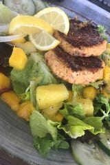 The crab cakes at Pier 220 in Titusville are a house favorite. Add them to a tropical salad for a fresh, satisfying meal.