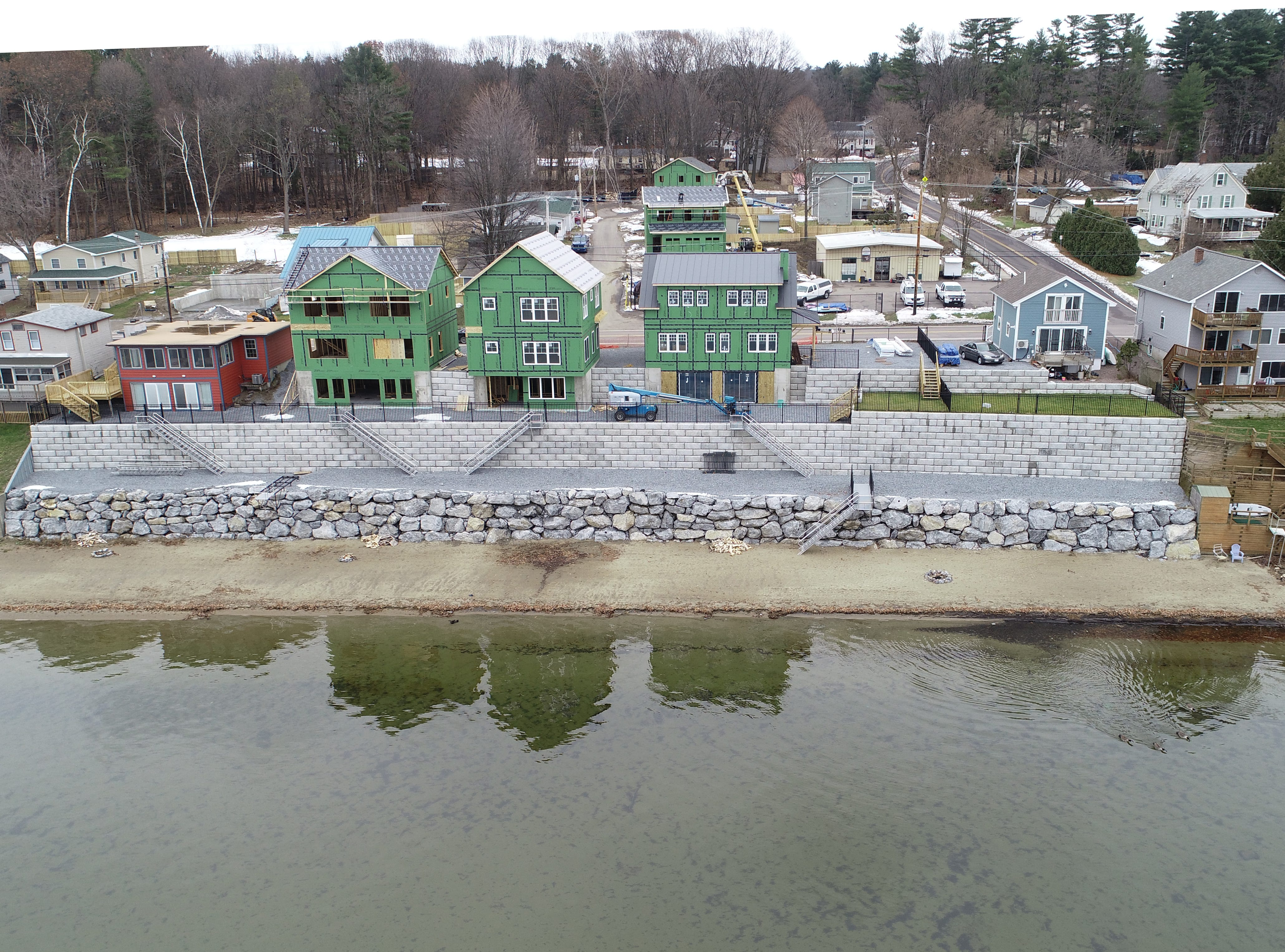 New homes (in green) are constructed along East Lakeshore Drive in Colchester, as viewed from a drone above Malletts Bay on Dec. 1, 2018.