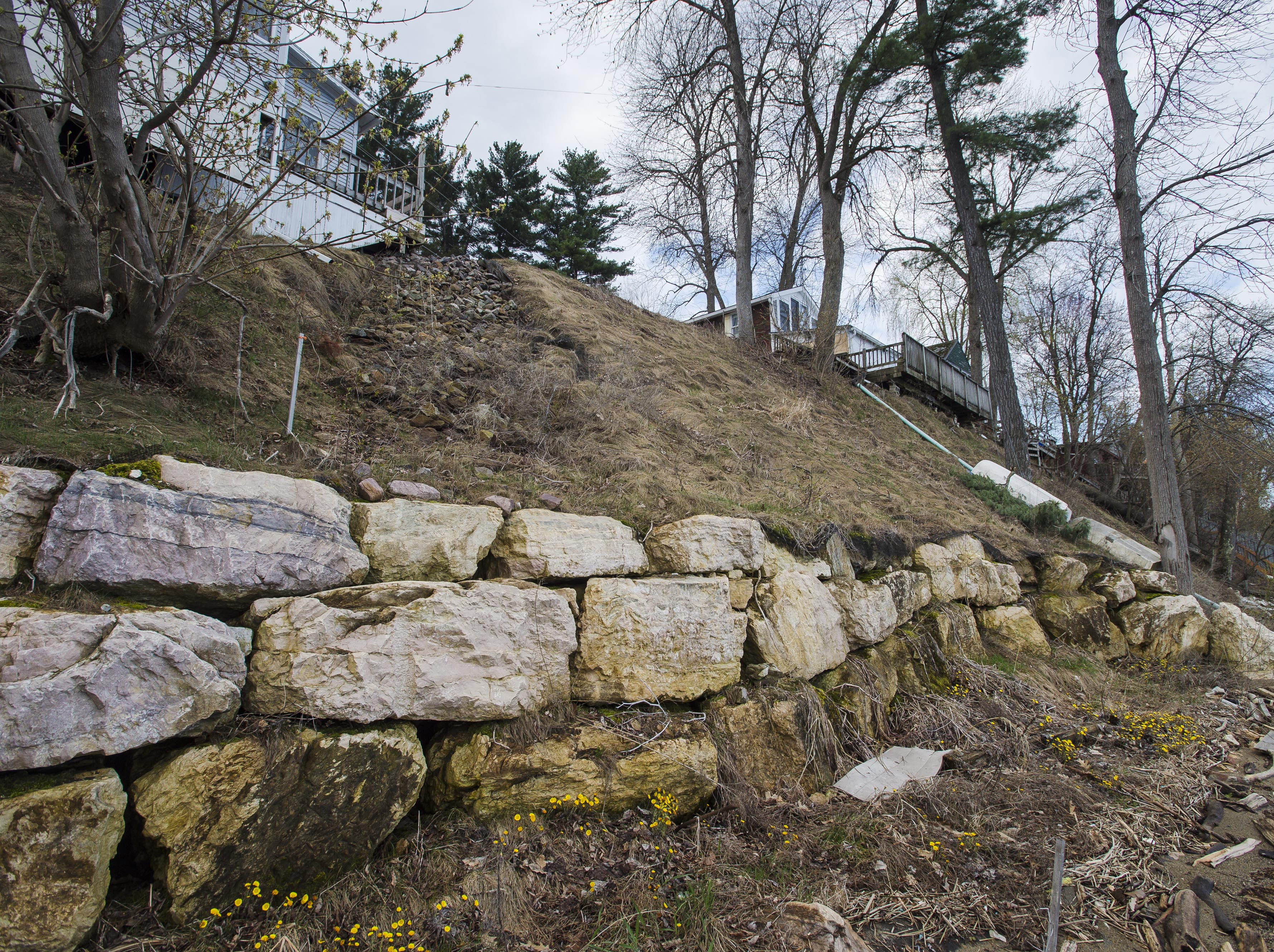 A low rock wall fortifies the shoreline below a home on East Lakeshore Drive in Colchester on Thursday, April 28, 2017.