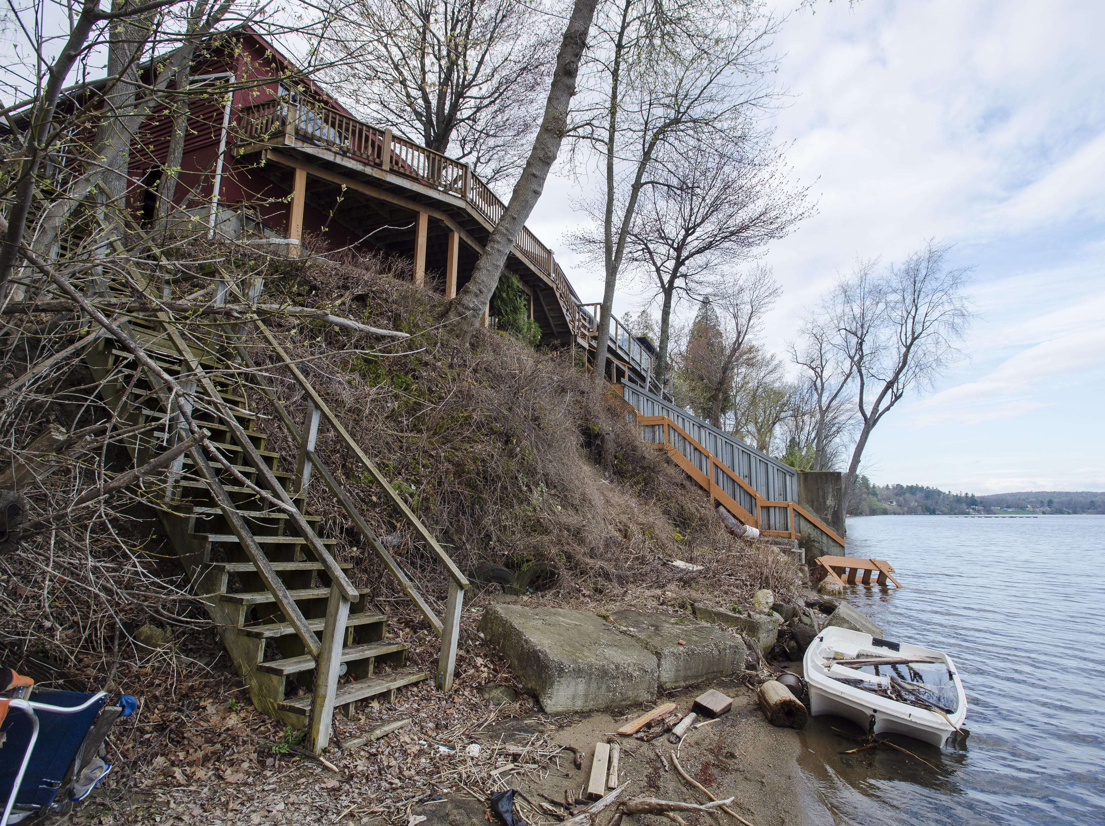 Low-lying concrete blocks line the shoreline below a home on East Lakeshore Drive in Colchester on Thursday, April 28, 2017.