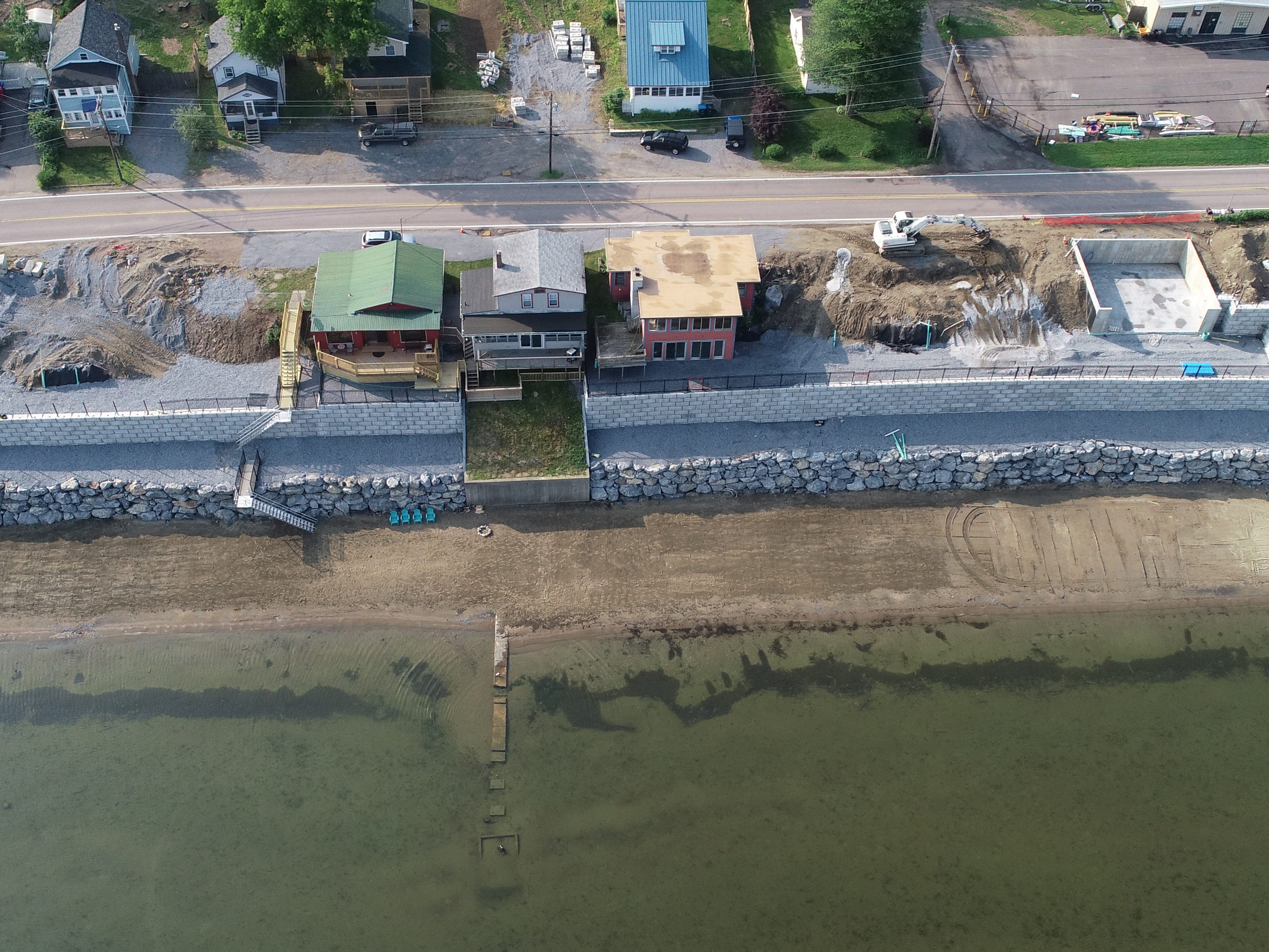 A new stone seawall and new homes are under construction on East Lakeshore Drive in Colchester on July 1, 2018.