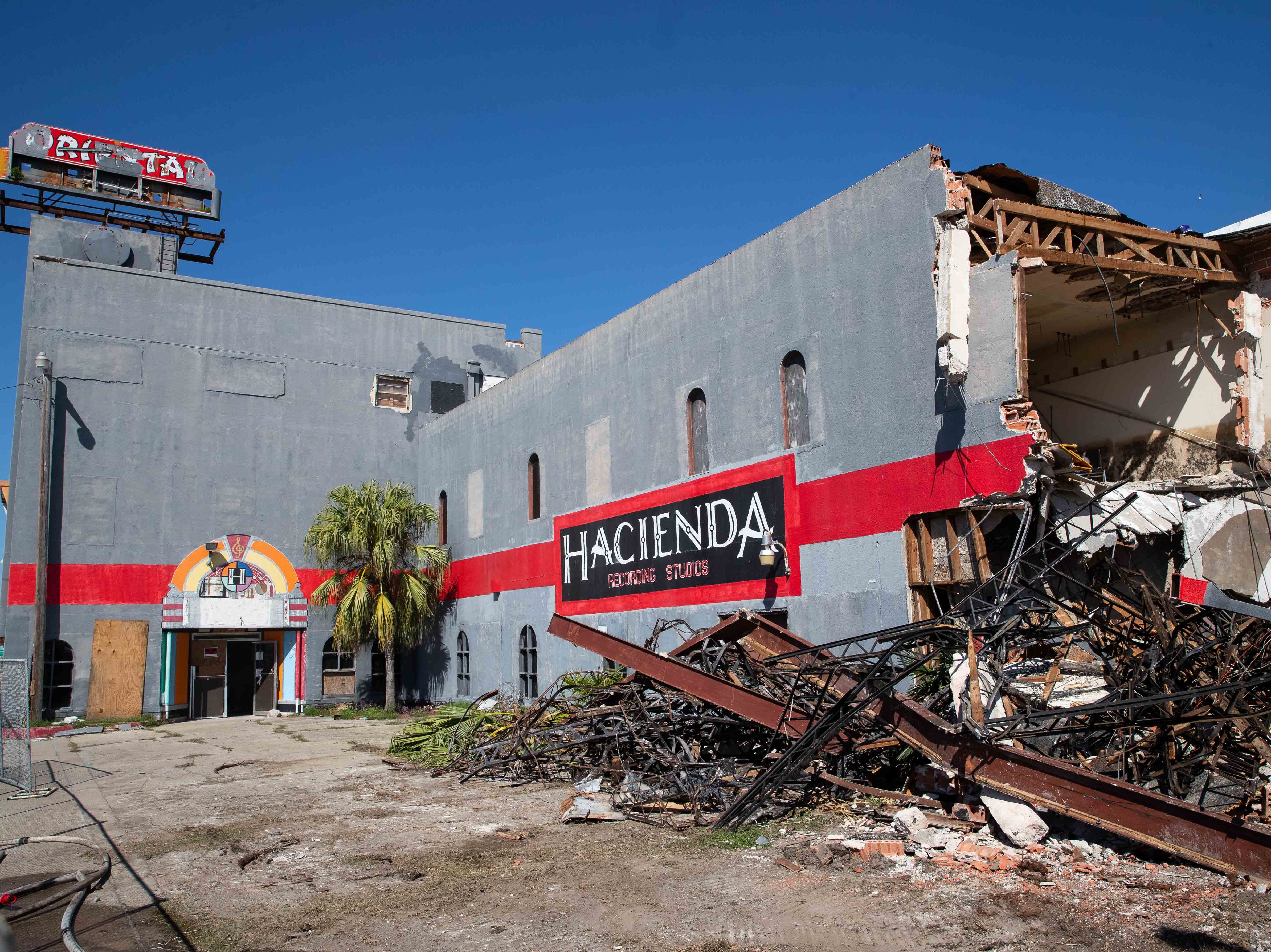 A demolition crew demolishes the old Hacienda Recording Studios on South Staples Street on Wednesday, Feb. 20, 2019.