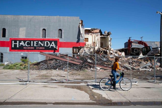 A demolition crew demolishes the old Hacienda Recording Studios on South Staples Street on Wednesday, Feb. 20, 2019.