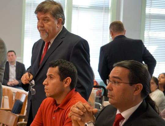 Hugo Rangel-Botello, seated in center, listens with his defense team as 105th District Judge Jack Pulcher addresses the court in Kleberg County on Feb. 20, 2019. Rangel-Botello is on trial for murder in connection with the shooting death of 22-year-old Gilbert Burrell in Kingsville in January 2015.