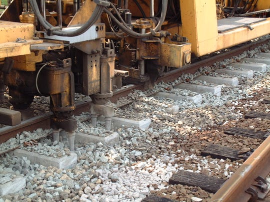 Track machinery lifts PATCO Hi-Speedline rails and vibrates rail ties to level the rail bed with the addition of new stone. Rail work like this is to begin by spring on most PATCO tracks in South Jersey to prevent rail damage and offer smoother train rides