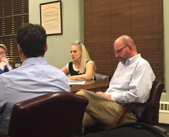 Haddonfield commissioner Jeffrey Kasko, right, attends a work session at borough hall on Tuesday night.