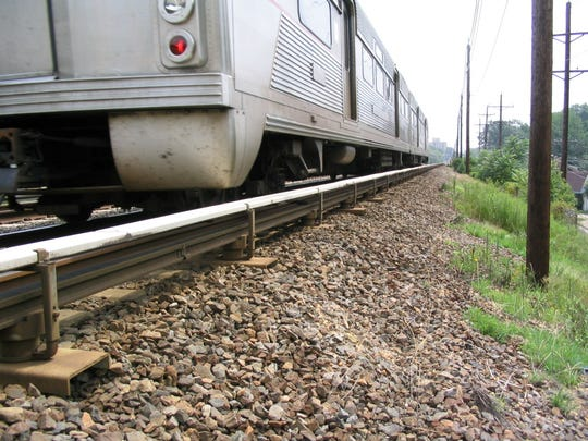 PATCO Hi-SPeedline train in Camden County passes over rails atop an embankment of stone ballast that will be more level and offer a smoother ride for passengers after the addition of more stone