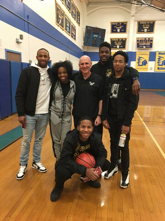 Camden Tech boys basketball coach Rob Sweeney (third from left) is retiring at the end of the season, his 20th with the Warriors. Standing (from left): Earon Trowery, Quraishah Bailey, Jalen Mickles and Davaughn Williams. Kneeling: Zayre Kinslow.