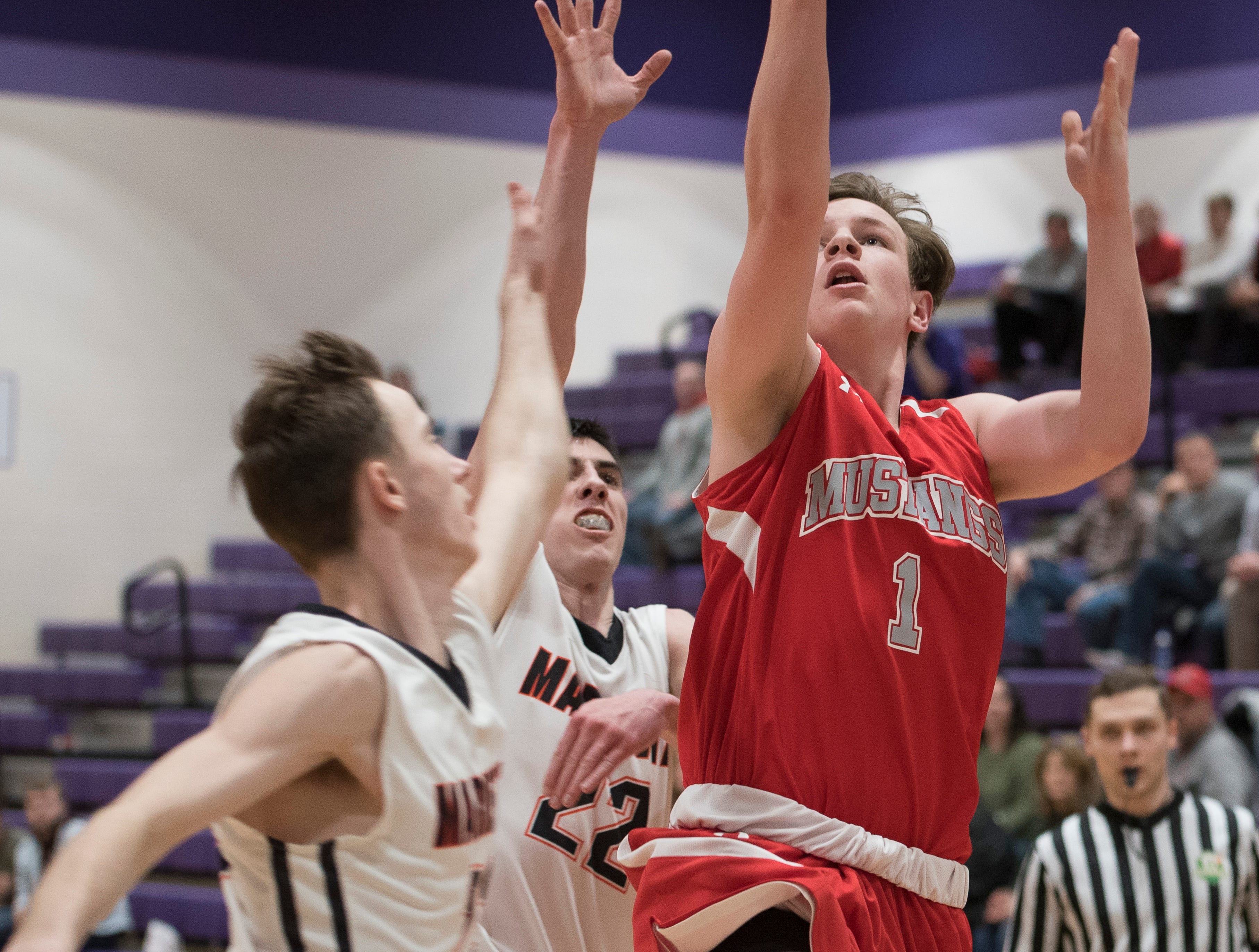 Westfall junior Jay Wyman scores against Marietta Tuesday night during a Division II sectional semifinal's game Tuesday night at Logan High School.