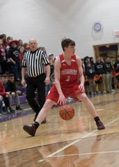 Westfall's Jay Wyman dribbles the ball during a 48-43 sectional semifinal game against Marietta at Logan High School.