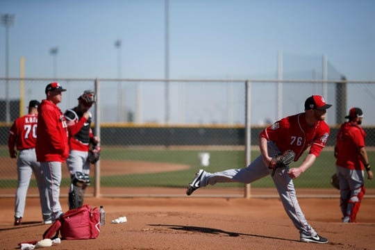 Cincinnati Reds relief pitcher Buddy Boshers (76) throws a pitch at the Cincinnati Reds spring training facility in Goodyear, Ariz., on Wednesday, Feb. 20, 2019.