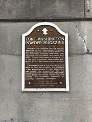 A historical marker on a parking garage at Broadway and Arch streets marks where the powder magazine for Fort Washington was found in 1952.