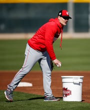 Cincinnati Reds manager David Bell (25) takes throws at second base at the Cincinnati Reds spring training facility in Goodyear, Ariz., on Wednesday, Feb. 20, 2019.