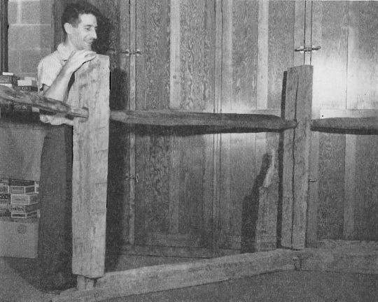 Raymond Baby, curator of archaeology at Ohio State University, stands with a portion of the newly discovered powder magazine from Fort Washington in 1953.