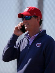 President of baseball operations Dick Williams talks on the phone at the Cincinnati Reds spring training facility in Goodyear, Ariz., on Wednesday, Feb. 20, 2019.
