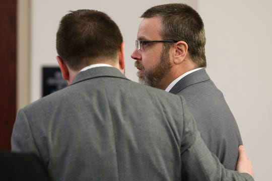 David Dooley's attorney speaks with him in February 2019, during a retrial, in which he was convicted, of killing Michelle Mockbee.