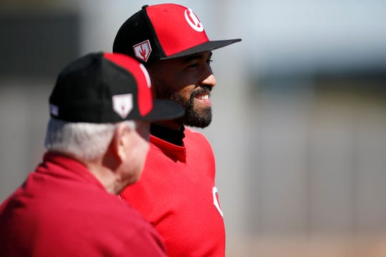 Cincinnati Reds outfielder Matt Kemp talks with team owner Bob Castellini at the Cincinnati Reds spring training facility in Goodyear, Ariz., on Wednesday, Feb. 20, 2019.