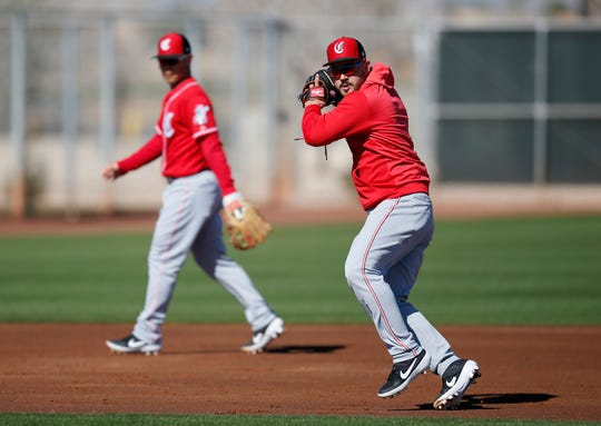 Cincinnati Reds third baseman Eugenio Suarez (7) makes a play during infield drills at the Cincinnati Reds spring training facility in Goodyear, Ariz., on Wednesday, Feb. 20, 2019.