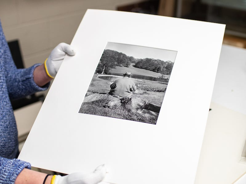 Sarah Potter holds the Winston Churchill photo found in the APSU Permanent Collection.
