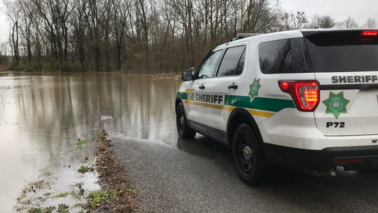 A Montgomery County Sheriff's Office vehicle stopped on CB Road, which was underwater on Wednesday, Feb. 20, 2019.