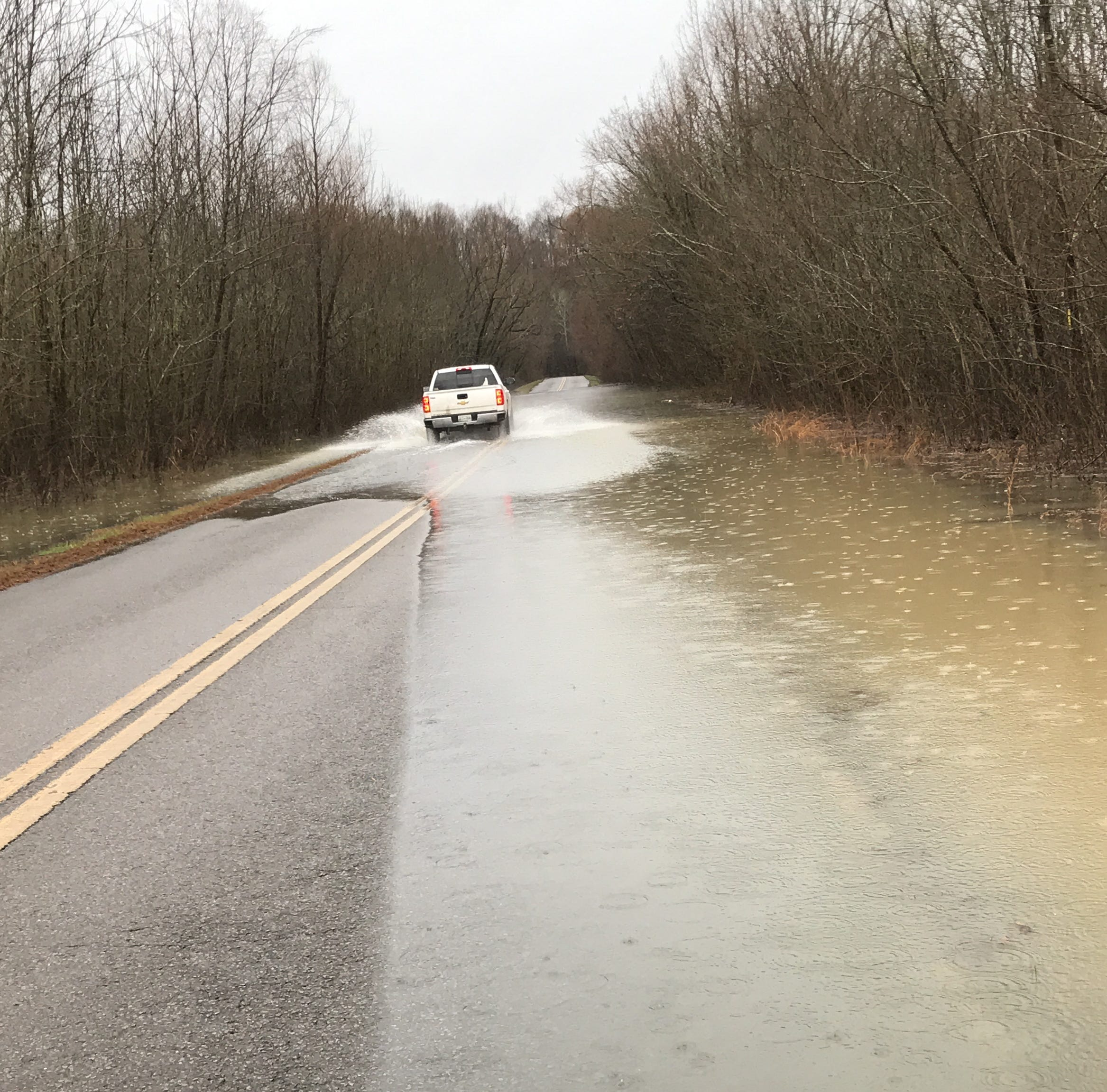 Rising waters turn roads to streams in Montgomery County