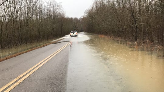 A truck risks crossing high water on Lock B Road in Montgomery County on Wednesday, Feb. 21, 2019.