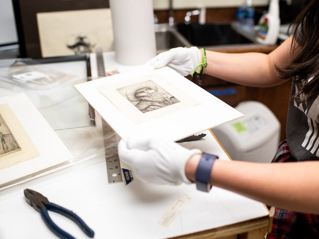Katherine Tolleson holds one of the Alphonse Legros drypoints she found in Austin Peay State University's Permanent Collection.