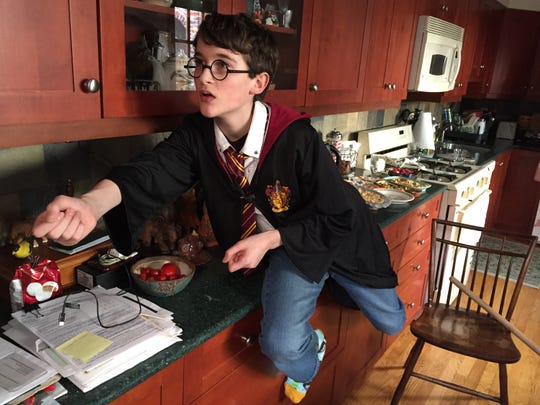 Perched on the kitchen counter, Charles Watson posed as Harry Potter for the 20th anniversary covers of the Harry Potter series as illustrated by family friend Brian Selznick.