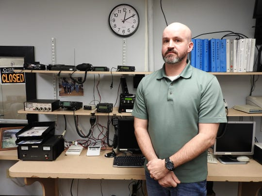 Rob McMasters, director of Coshocton County Emergency Management Agency, with some of the radio equipment and technology they use to monitor and for communication when disasters strike locally.