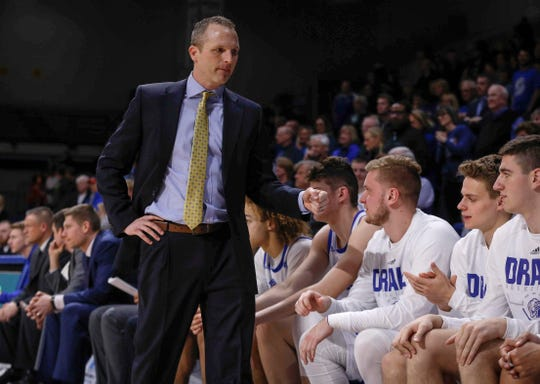 Drake mens head basketball coach Darian DeVries gives his team fist bumps following a win over Bradley on Tuesday, Feb. 19, 2019, at the Knapp Center in Des Moines.
