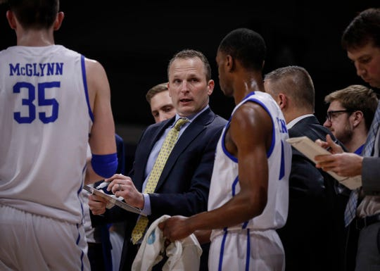 Drake mens head basketball coach Darian DeVries talks to his team during a timeout against Bradley on Tuesday, Feb. 19, 2019, at the Knapp Center in Des Moines.