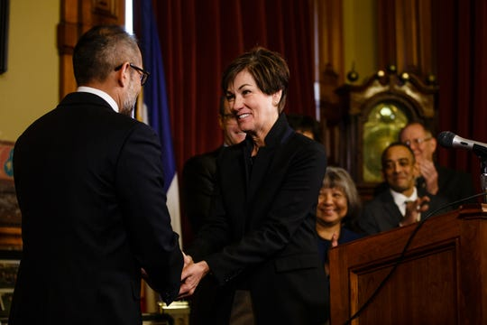 Gov. Kim Reynolds shakes hands with Appeals court judge Christopher McDonald as her second Supreme Court nominee on Wednesday, Feb. 20, 2019 in Des Moines. McDonald is the first Asian American who will serve on the Iowa Supreme Court.