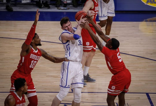 Drake senior Nick McGlynn is covered tight by Bradley junior Darrell Brown, right, and Elijah Childs in the second half on Tuesday, Feb. 19, 2019, at the Knapp Center in Des Moines.