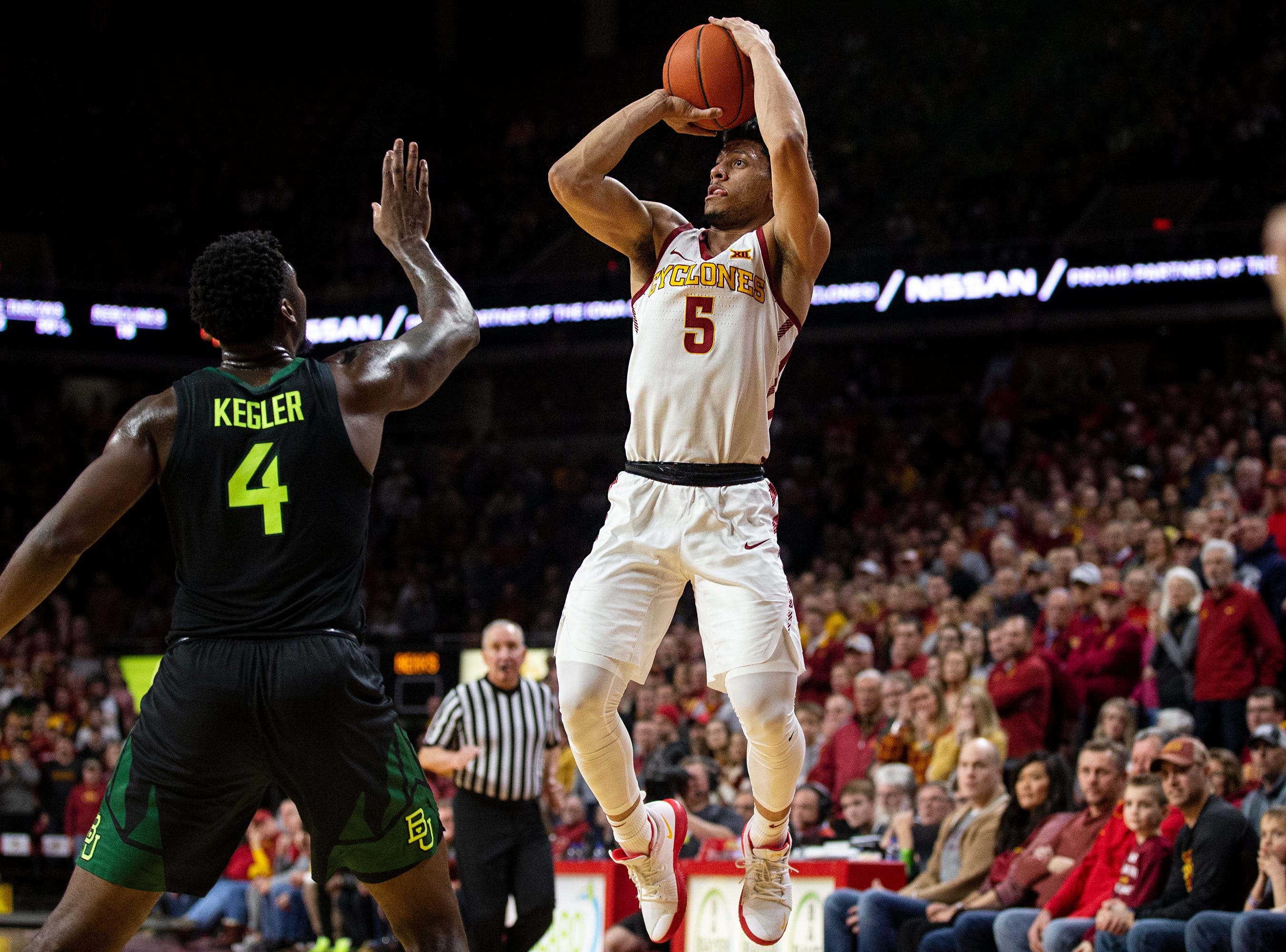 Iowa State's Lindell Wigginton shoots a three pointer during the Iowa State men's basketball game against Baylor on Tuesday, Feb. 19, 2019, in Hilton Coliseum.