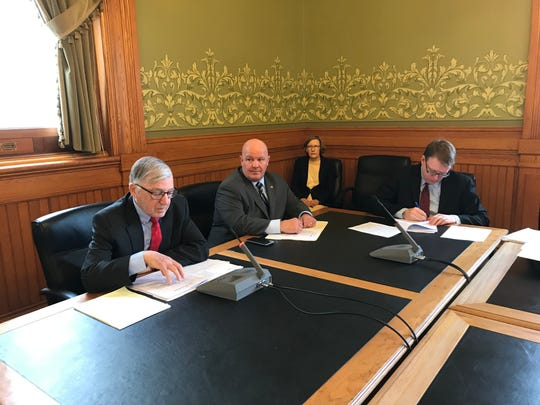 Senators Julian Garrett (left), Jason Schultz and Rob Hogg discuss a bill that would require employers in Iowa to use the federal E-Verify system and create penalties for those that knowingly hire undocumented workers. The Senate Judiciary subcommittee met Wednesday, Feb. 20, 2019.