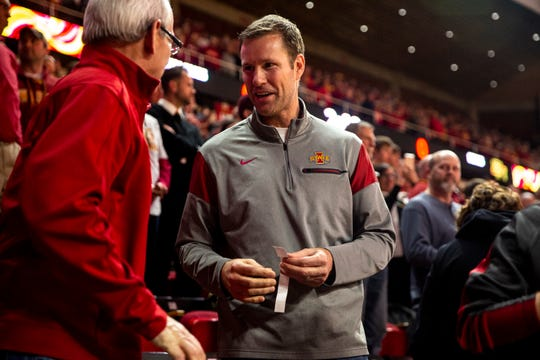 Fred Hoiberg, former Iowa State coach and player, stops to talk with people in the stands before the Iowa State men's basketball game against Baylor on Tuesday, Feb. 19, 2019, in Hilton Coliseum.